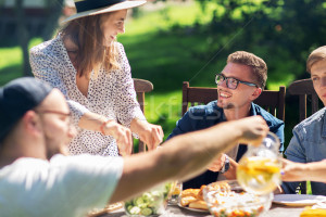 7876177_stock-photo-happy-friends-having-dinner-at-summer-garden-party
